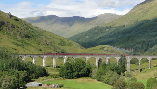 The Jacobite Train Crossing the Glenfinnan Viaduct
